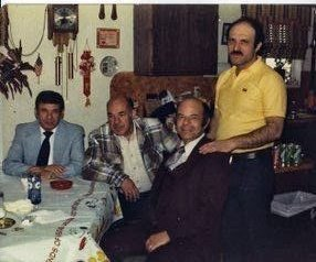 My dad on the right, with his uncles and my grandfather (middle in the plaid).  Never mess with tradition